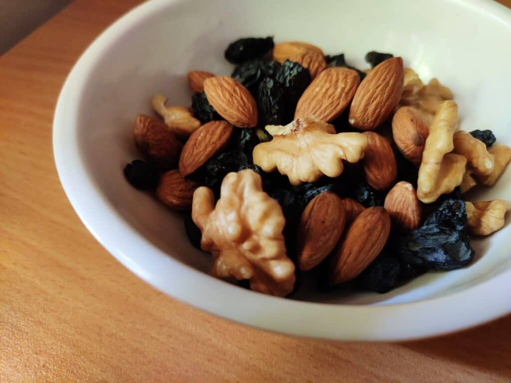 brown and black nuts on white ceramic bowl